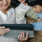 grandparent holding tablet