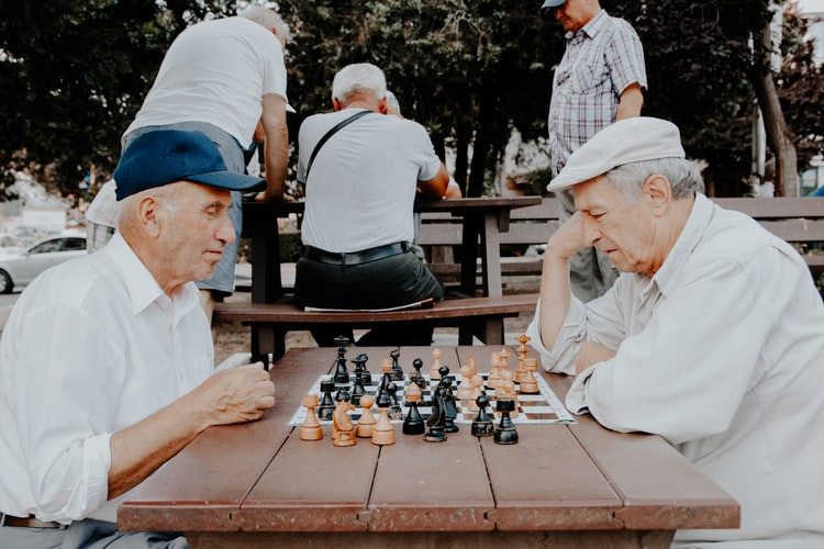 Older adults playing chess