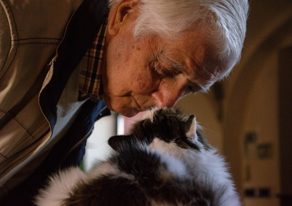 Older adult with a cat